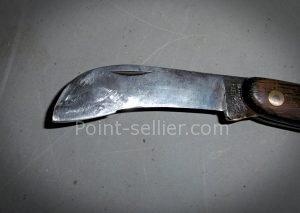 Ancienne serpette transformée en outil pour couper le cuir